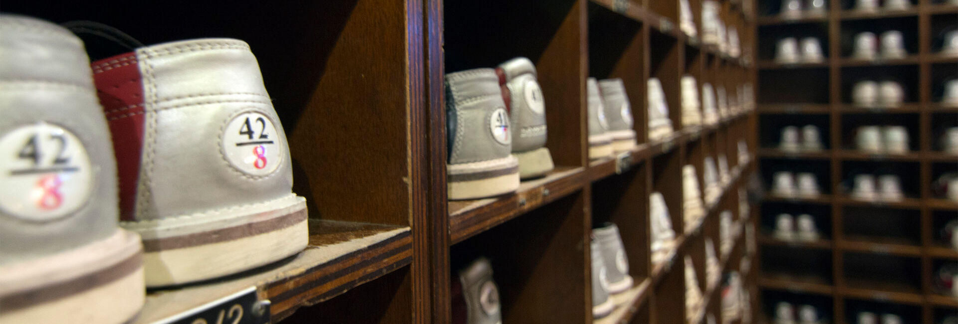 Shelves with bowling shoes in various sizes