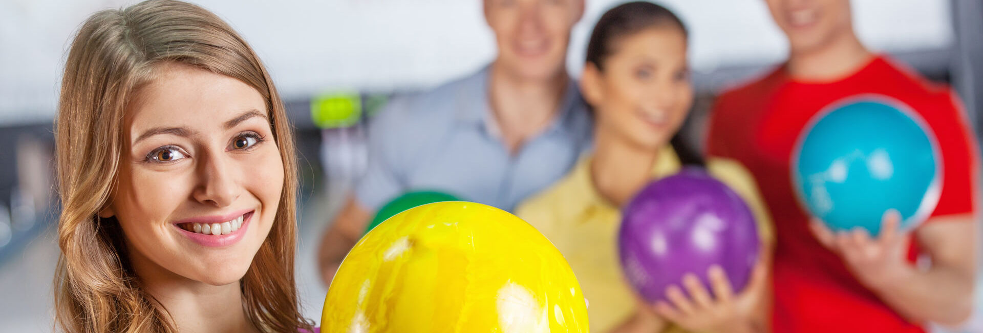 School kids holding a bowling ball