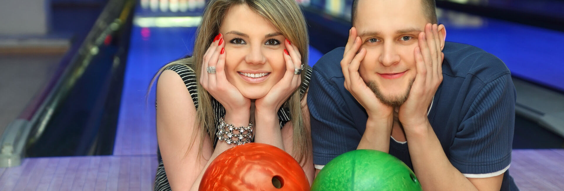 Couple in front of a bowling lane