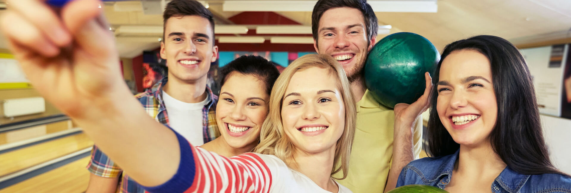 Friends making a selfie at the bowling lanes